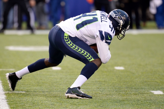 Dec 15, 2013; East Rutherford, NJ, USA; Seattle Seahawks cornerback Byron Maxwell (41) intercepts a pass against the New York Giants during the second half at MetLife Stadium. Mandatory Credit: Joe Camporeale-USA TODAY Sports