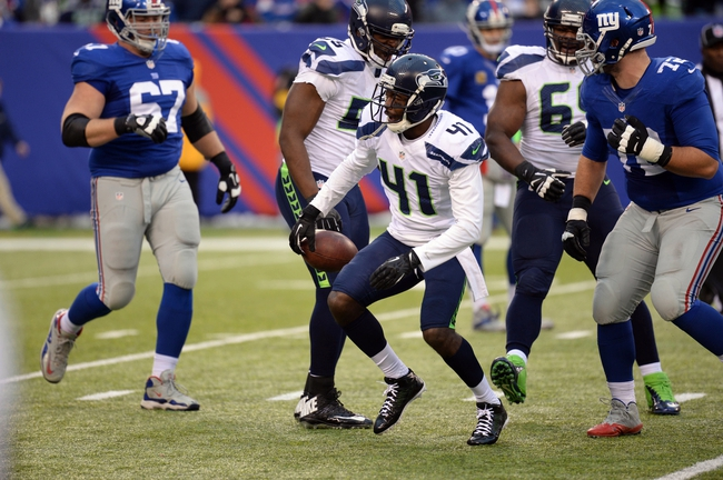 Dec 15, 2013; East Rutherford, NJ, USA; Seattle Seahawks cornerback Byron Maxwell (41) celebrates an interception against the New York Giants during the second half at MetLife Stadium. Mandatory Credit: Joe Camporeale-USA TODAY Sports