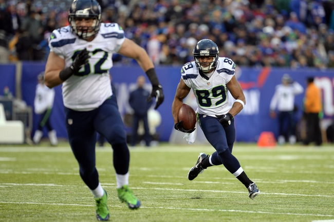 Dec 15, 2013; East Rutherford, NJ, USA; Seattle Seahawks wide receiver Doug Baldwin (89) follows the block of tight end Luke Willson (82) against the New York Giants during the second half at MetLife Stadium. Mandatory Credit: Joe Camporeale-USA TODAY Sports