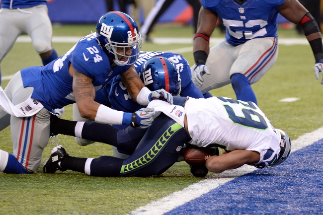Dec 15, 2013; East Rutherford, NJ, USA; Seattle Seahawks wide receiver Doug Baldwin (89) scores a touchdown past New York Giants defensive end Mathias Kiwanuka (94) and cornerback Terrell Thomas (24) in the second half during the game at MetLife Stadium. Mandatory Credit: Robert Deutsch-USA TODAY Sports