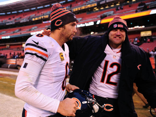 Dec 15, 2013; Cleveland, OH, USA; Chicago Bears quarterback Jay Cutler (6) celebrates with quarterback Josh McCown (12) after defeating the Cleveland Browns 38-31 at FirstEnergy Stadium. Mandatory Credit: Andrew Weber-USA TODAY Sports