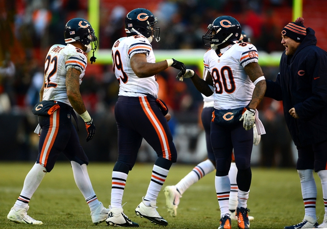 Dec 15, 2013; Cleveland, OH, USA; Chicago Bears running back Michael Bush (29) celebrates with teammates after scoring a touchdown during the fourth quarter against the Cleveland Browns at FirstEnergy Stadium. Mandatory Credit: Andrew Weber-USA TODAY Sports
