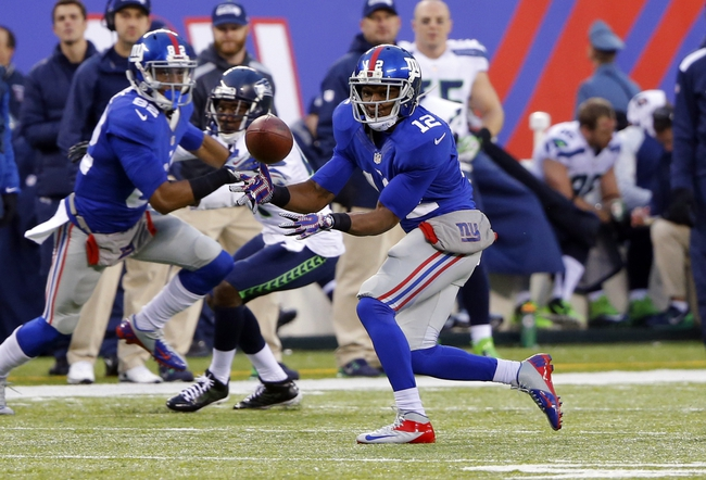 Dec 15, 2013; East Rutherford, NJ, USA;  New York Giants wide receiver Jerrel Jernigan (12) makes a reception during the second half against the Seattle Seahawks at MetLife Stadium. Seattle Seahawks defeat the New York Giants 23-0. Mandatory Credit: Jim O'Connor-USA TODAY Sports