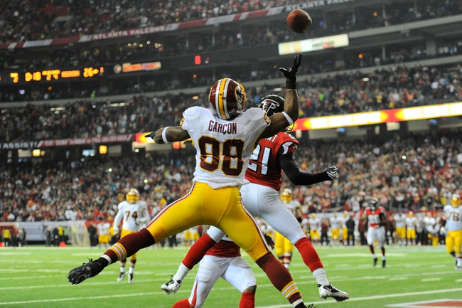 Dec 15, 2013; Atlanta, GA, USA; Atlanta Falcons cornerback Desmond Trufant (21) breaks up a two point conversion pass attempt intended for Washington Redskins wide receiver Pierre Garcon (88) during the fourth quarter at the Georgia Dome. The Falcons defeated the Redskins 27-26. Mandatory Credit: Dale Zanine-USA TODAY Sports