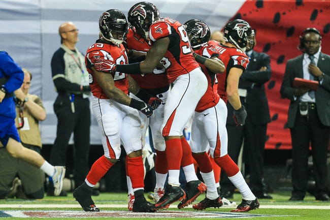 Dec 15, 2013; Atlanta, GA, USA; Atlanta Falcons strong safety William Moore (25) celebrates an interception in the second half against the Washington Redskins at the Georgia Dome. The Falcons won 27-26. Mandatory Credit: Daniel Shirey-USA TODAY Sports