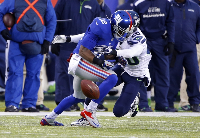 Dec 15, 2013; East Rutherford, NJ, USA;  Seattle Seahawks cornerback Jeremy Lane (20) breaks up  a pass intended for New York Giants wide receiver Jerrel Jernigan (12) during the second half at MetLife Stadium. Seattle Seahawks defeat the New York Giants 23-0. Mandatory Credit: Jim O'Connor-USA TODAY Sports
