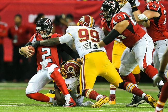 Dec 15, 2013; Atlanta, GA, USA; Atlanta Falcons quarterback Matt Ryan (2) is sacked by Washington Redskins defensive end Jarvis Jenkins (99) in the second half at the Georgia Dome. The Falcons won 27-26. Mandatory Credit: Daniel Shirey-USA TODAY Sports