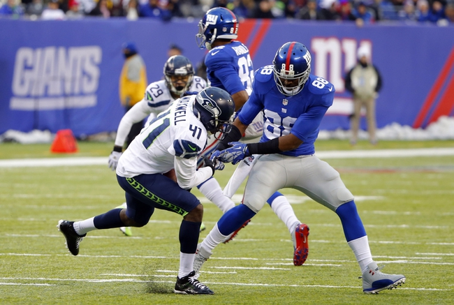 Dec 15, 2013; East Rutherford, NJ, USA;  Seattle Seahawks cornerback Byron Maxwell (41) intercepts pass intended for New York Giants wide receiver Hakeem Nicks (88) during the second half at MetLife Stadium. Seattle Seahawks defeat the New York Giants 23-0. Mandatory Credit: Jim O'Connor-USA TODAY Sports