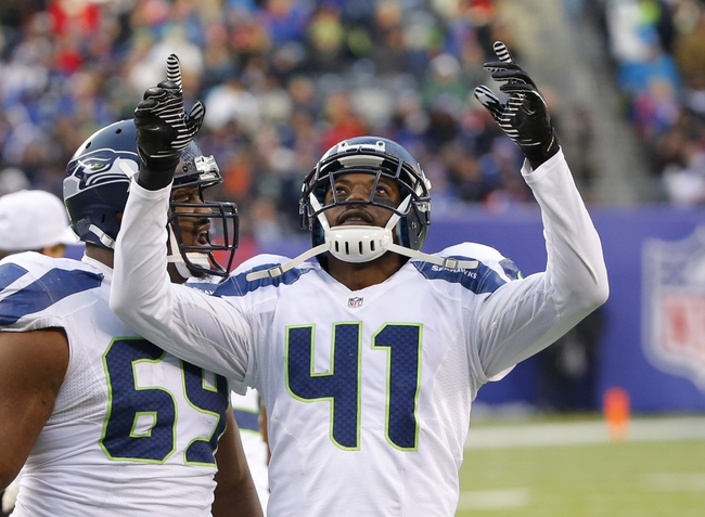 Dec 15, 2013; East Rutherford, NJ, USA;  Seattle Seahawks cornerback Byron Maxwell (41) celebrates an interception during the second half against the New York Giants at MetLife Stadium. Seattle Seahawks defeat the New York Giants 23-0. Mandatory Credit: Jim O'Connor-USA TODAY Sports