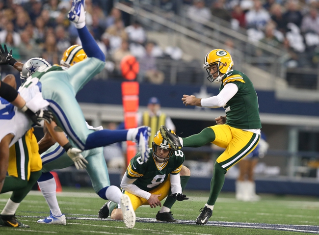 Dec 15, 2013; Arlington, TX, USA; Green Bay Packers kicker Mason Crosby (2) kicks a field goal in the first quarter against the Dallas Cowboys at AT&T Stadium. Mandatory Credit: Matthew Emmons-USA TODAY Sports