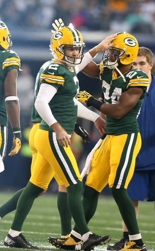 Dec 15, 2013; Arlington, TX, USA; Green Bay Packers kicker Mason Crosby (2) celebrates his field goal in the first quarter with cornerback Jarrett Bush (24) against the Dallas Cowboys at AT&T Stadium. Mandatory Credit: Matthew Emmons-USA TODAY Sports