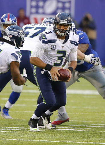 Dec 15, 2013; East Rutherford, NJ, USA;  Seattle Seahawks quarterback Russell Wilson (3) gets ready to hand the ball off during the second half against the New York Giants at MetLife Stadium. Seattle Seahawks defeat the New York Giants 23-0. Mandatory Credit: Jim O'Connor-USA TODAY Sports