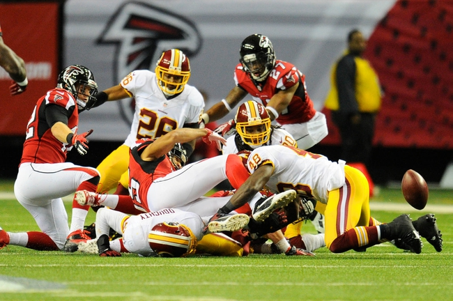 Dec 15, 2013; Atlanta, GA, USA; The Washington Redskins can't recover an insides kick against the Atlanta Falcons during the second half at the Georgia Dome. The Falcons defeated the Redskins 27-26. Mandatory Credit: Dale Zanine-USA TODAY Sports
