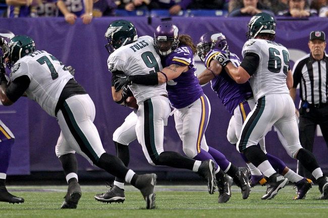 Dec 15, 2013; Minneapolis, MN, USA; Philadelphia Eagles quarterback Nick Foles (9) is sacked by Minnesota Vikings defensive end Brian Robison (96) during the fourth quarter at Mall of America Field at H.H.H. Metrodome. The Vikings defeated the Eagles 48-30. Mandatory Credit: Brace Hemmelgarn-USA TODAY Sports