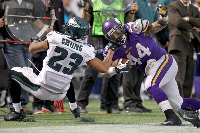 Dec 15, 2013; Minneapolis, MN, USA; Minnesota Vikings running back Matt Asiata (44) is tackled by Philadelphia Eagles safety Patrick Chung (23) during the fourth quarter at Mall of America Field at H.H.H. Metrodome. The Vikings defeated the Eagles 48-30. Mandatory Credit: Brace Hemmelgarn-USA TODAY Sports
