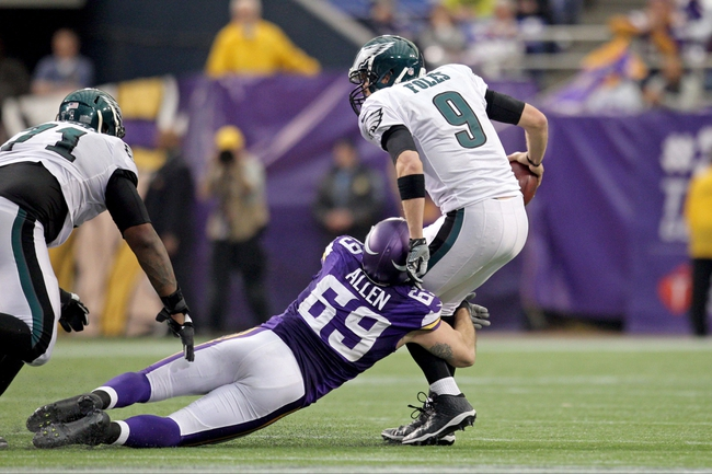 Dec 15, 2013; Minneapolis, MN, USA; Philadelphia Eagles quarterback Nick Foles (9) is sacked by Minnesota Vikings defensive end Jared Allen (69) during the fourth quarter at Mall of America Field at H.H.H. Metrodome. The Vikings defeated the Eagles 48-30. Mandatory Credit: Brace Hemmelgarn-USA TODAY Sports