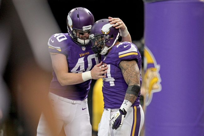 Dec 15, 2013; Minneapolis, MN, USA; Minnesota Vikings running back Matt Asiata (44) celebrates his touchdown with tight end Rhett Ellison (40) during the fourth quarter against the Philadelphia Eagles at Mall of America Field at H.H.H. Metrodome. The Vikings defeated the Eagles 48-30. Mandatory Credit: Brace Hemmelgarn-USA TODAY Sports