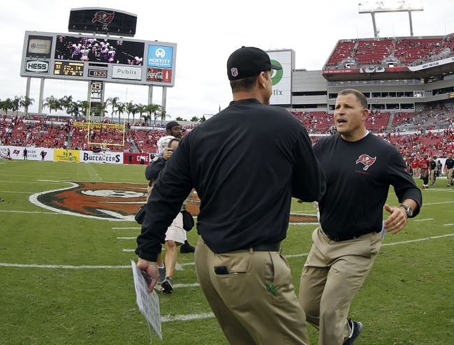 Dec 15, 2013; Tampa, FL, USA; San Francisco 49ers head coach Jim Harbaugh and Tampa Bay Buccaneers head coach Greg Schiano greet at the end of the game at Raymond James Stadium. San Francisco 49ers defeated the Tampa Bay Buccaneers 33-14. Mandatory Credit: Kim Klement-USA TODAY Sports