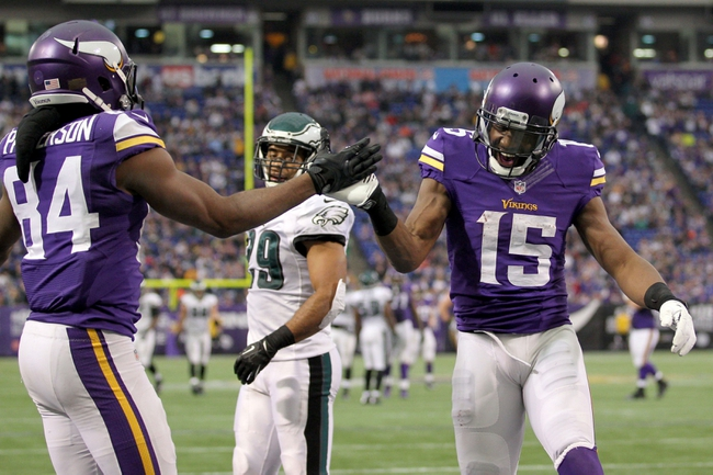 Dec 15, 2013; Minneapolis, MN, USA; Minnesota Vikings wide receiver Greg Jennings (15) celebrates with wide receiver Cordarrelle Patterson (84) during the fourth quarter against the Philadelphia Eagles at Mall of America Field at H.H.H. Metrodome. The Vikings defeated the Eagles 48-30. Mandatory Credit: Brace Hemmelgarn-USA TODAY Sports