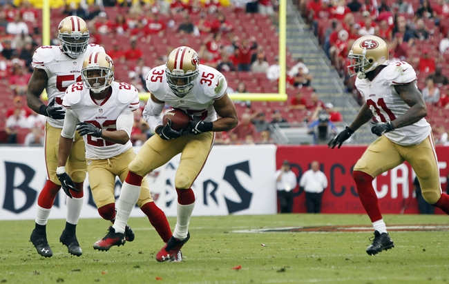 Dec 15, 2013; Tampa, FL, USA; San Francisco 49ers free safety Eric Reid (35) intercepts the ball during the second half against the Tampa Bay Buccaneers at Raymond James Stadium. San Francisco 49ers defeated the Tampa Bay Buccaneers 33-14. Mandatory Credit: Kim Klement-USA TODAY Sports