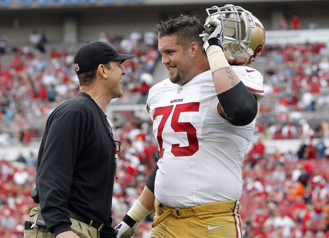 Dec 15, 2013; Tampa, FL, USA; San Francisco 49ers head coach Jim Harbaugh smiles with guard Alex Boone (75) after they scored a touchdown against the Tampa Bay Buccaneers during the second half at Raymond James Stadium. San Francisco 49ers defeated the Tampa Bay Buccaneers 33-14. Mandatory Credit: Kim Klement-USA TODAY Sports