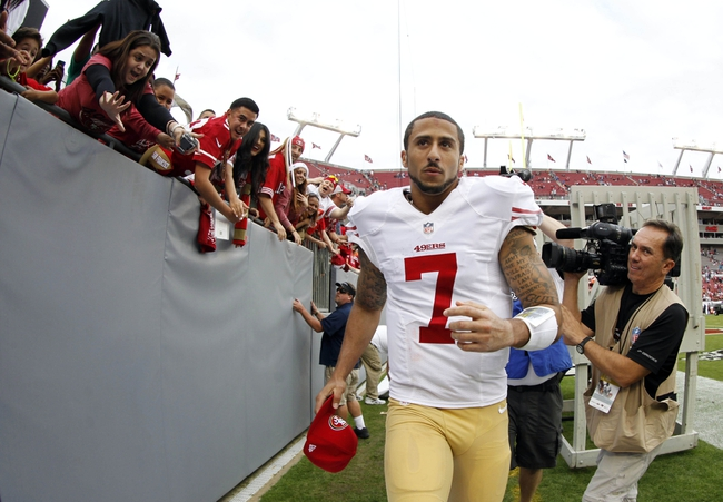 Dec 15, 2013; Tampa, FL, USA; San Francisco 49ers quarterback Colin Kaepernick (7) runs into the tunnel after they beat the Tampa Bay Buccaneers at Raymond James Stadium. San Francisco 49ers defeated the Tampa Bay Buccaneers 33-14. Mandatory Credit: Kim Klement-USA TODAY Sports
