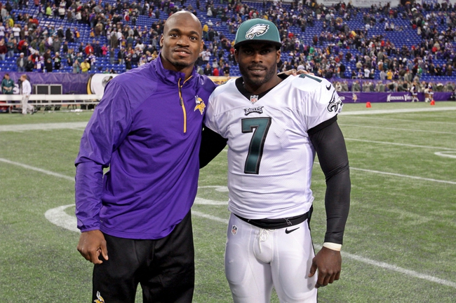 Dec 15, 2013; Minneapolis, MN, USA; Minnesota Vikings running back Adrian Peterson (28) and Philadelphia Eagles quarterback Michael Vick (7) pose for a photo following the game at Mall of America Field at H.H.H. Metrodome. The Vikings defeated the Eagles 48-30. Mandatory Credit: Brace Hemmelgarn-USA TODAY Sports