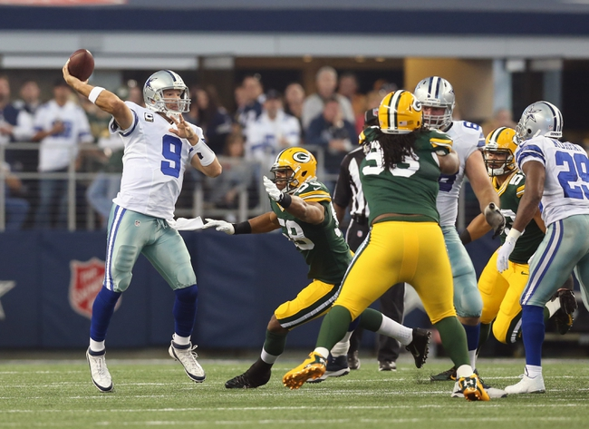 Dec 15, 2013; Arlington, TX, USA; Dallas Cowboys quarterback Tony Romo (9) throws in the pocket in the first quarter against the Green Bay Packers at AT&T Stadium. Mandatory Credit: Matthew Emmons-USA TODAY Sports