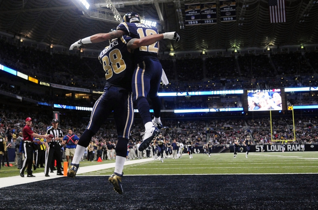 Dec 15, 2013; St. Louis, MO, USA; St. Louis Rams tight end Lance Kendricks (88) celebrates with wide receiver Stedman Bailey (12) after catching a four yard touchdown pass against the New Orleans Saints during the first half at the Edward Jones Dome. Mandatory Credit: Jeff Curry-USA TODAY Sports