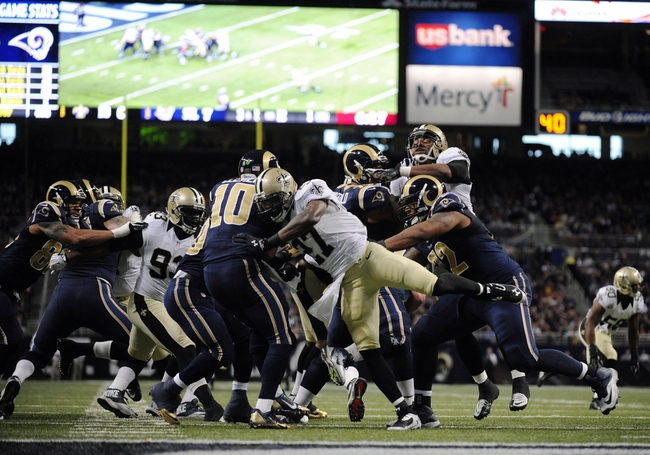Dec 15, 2013; St. Louis, MO, USA; New Orleans Saints free safety Malcolm Jenkins (27) hits St. Louis Rams quarterback Kellen Clemens (10) after the pass during the first half at the Edward Jones Dome. Mandatory Credit: Jeff Curry-USA TODAY Sports