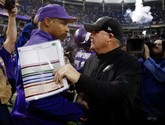 Dec 15, 2013; Minneapolis, MN, USA; Minnesota Vikings head coach Leslie Frazier meets with Philadelphia Eagles head coach Chip Kelly after the game at Mall of America Field at H.H.H. Metrodome. The Vikings win 48-30. Mandatory Credit: Bruce Kluckhohn-USA TODAY Sports