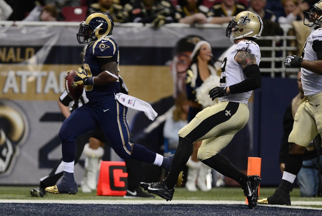 Dec 15, 2013; St. Louis, MO, USA; St. Louis Rams running back Zac Stacy (30) scores on a 40 yard touchdown against the New Orleans Saints during the first half at the Edward Jones Dome. Mandatory Credit: Jeff Curry-USA TODAY Sports