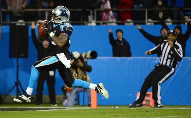 Dec 15, 2013; Charlotte, NC, USA; Carolina Panthers cornerback Captain Munnerlyn (41) returns an interception for a touchdown in the fourth quarter against the New York Jets at Bank of America Stadium. Mandatory Credit: Bob Donnan-USA TODAY Sports
