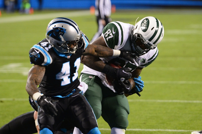 Dec 15, 2013; Charlotte, NC, USA; New York Jets tight end Jeff Cumberland (87) scores a touchdown as Carolina Panthers cornerback Captain Munnerlyn (41) defends in the fourth quarter. The Panthers defeated the Jets 30-20 at Bank of America Stadium. Mandatory Credit: Bob Donnan-USA TODAY Sports