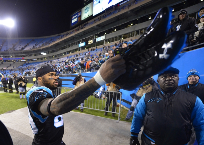 Dec 15, 2013; Charlotte, NC, USA; Carolina Panthers wide receiver Steve Smith (89) hands his shoes to a fan after the game. The Panthers defeated the Jets 30-20 at Bank of America Stadium. Mandatory Credit: Bob Donnan-USA TODAY Sports
