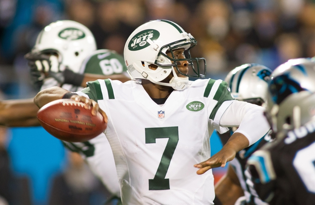 Dec 15, 2013; Charlotte, NC, USA; New York Jets quarterback Geno Smith (7) throws a pass during the third quarter against the Carolina Panthers at Bank of America Stadium. Panthers defeated the Jets 30-20. Mandatory Credit: Jeremy Brevard-USA TODAY Sports
