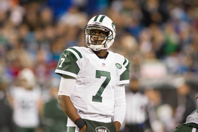 Dec 15, 2013; Charlotte, NC, USA; New York Jets quarterback Geno Smith (7) watches a replay during the third quarter against the Carolina Panthers at Bank of America Stadium. Panthers defeated the Jets 30-20. Mandatory Credit: Jeremy Brevard-USA TODAY Sports