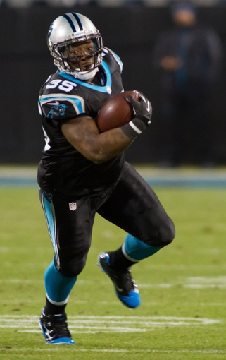 Dec 15, 2013; Charlotte, NC, USA; Carolina Panthers fullback Mike Tolbert (35) runs the ball during the third quarter against the New York Jets at Bank of America Stadium. Panthers defeated the Jets 30-20. Mandatory Credit: Jeremy Brevard-USA TODAY Sports
