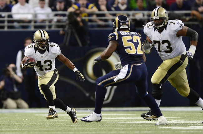 Dec 15, 2013; St. Louis, MO, USA; New Orleans Saints running back Darren Sproles (43) carries the ball as St. Louis Rams outside linebacker Alec Ogletree (52) defends during the first half at the Edward Jones Dome. The Rams defeated the Saints 27-16. Mandatory Credit: Jeff Curry-USA TODAY Sports