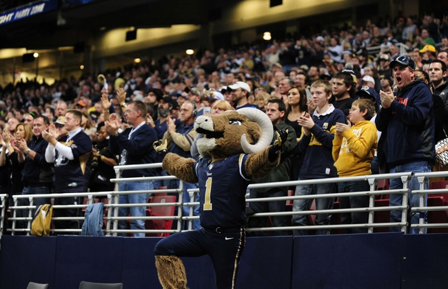 Dec 15, 2013; St. Louis, MO, USA; St. Louis Rams mascot Rampage hypes up the crowd during the first half against the New Orleans Saints at the Edward Jones Dome. The Rams defeated the Saints 27-16. Mandatory Credit: Jeff Curry-USA TODAY Sports