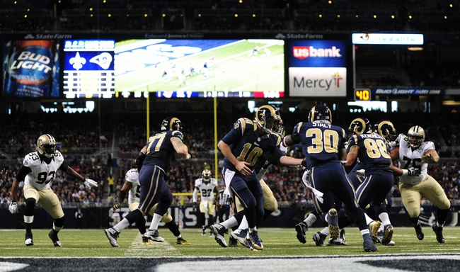 Dec 15, 2013; St. Louis, MO, USA; St. Louis Rams quarterback Kellen Clemens (10) hands off to running back Zac Stacy (30) during the first half of a game against the New Orleans Saints at the Edward Jones Dome. The Rams defeated the Saints 27-16. Mandatory Credit: Jeff Curry-USA TODAY Sports