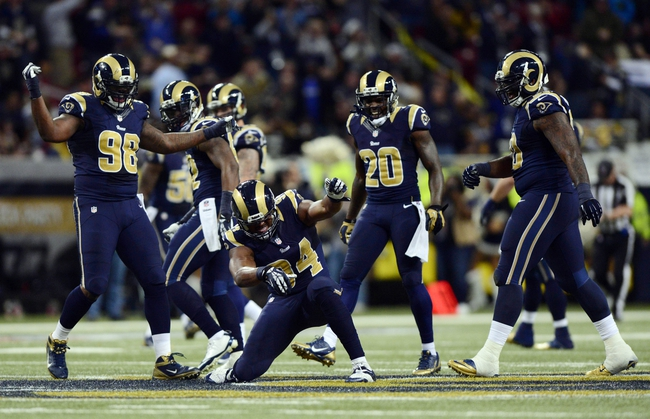 Dec 15, 2013; St. Louis, MO, USA; St. Louis Rams defensive end Robert Quinn (94) celebrates after causing and recovering a fumble by New Orleans Saints quarterback Drew Brees (not pictured) during the second half at the Edward Jones Dome. The Rams defeated the Saints 27-16. Mandatory Credit: Jeff Curry-USA TODAY Sports