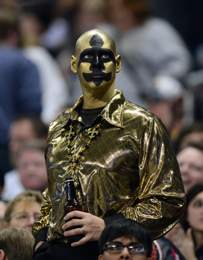 Dec 15, 2013; St. Louis, MO, USA; New Orleans Saints fan looks on as his team plays the St. Louis Rams during the second half at the Edward Jones Dome. The Rams defeated the Saints 27-16. Mandatory Credit: Jeff Curry-USA TODAY Sports