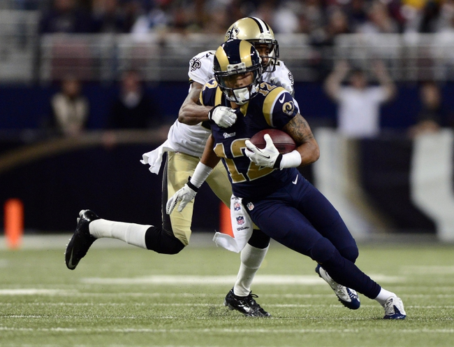 Dec 15, 2013; St. Louis, MO, USA; St. Louis Rams wide receiver Stedman Bailey (12) carries the ball as New Orleans Saints cornerback Keenan Lewis (28) defends during the second half at the Edward Jones Dome. The Rams defeated the Saints 27-16. Mandatory Credit: Jeff Curry-USA TODAY Sports