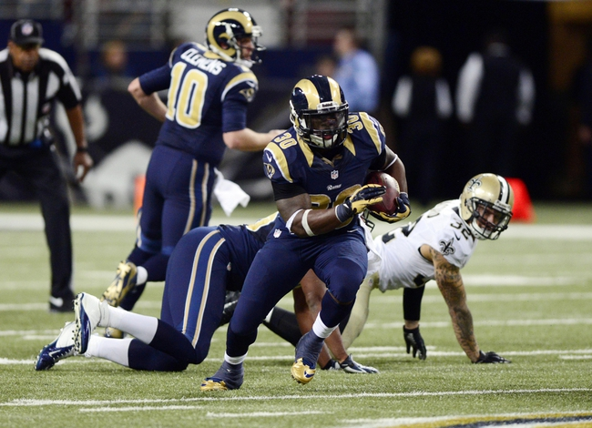 Dec 15, 2013; St. Louis, MO, USA; St. Louis Rams running back Zac Stacy (30) carries the ball against the New Orleans Saints during the second half at the Edward Jones Dome. The Rams defeated the Saints 27-16. Mandatory Credit: Jeff Curry-USA TODAY Sports
