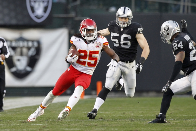 Dec 15, 2013; Oakland, CA, USA; Kansas City Chiefs running back Jamaal Charles (25) catches a 71 yard touchdown pass against the Oakland Raiders in the third quarter at O.co Coliseum. The Chiefs defeated the Raiders 56-31. Mandatory Credit: Cary Edmondson-USA TODAY Sports
