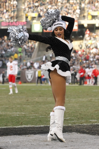 Dec 15, 2013; Oakland, CA, USA; An Oakland Raiders cheerleader performs during a timeout against the Kansas City Chiefs in the third quarter at O.co Coliseum. The Chiefs defeated the Raiders 56-31. Mandatory Credit: Cary Edmondson-USA TODAY Sports