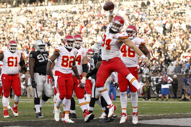 Dec 15, 2013; Oakland, CA, USA; Kansas City Chiefs tight end Sean McGrath (84) fakes a spike in the end zone after catching a touchdown against the Oakland Raiders in the third quarter at O.co Coliseum. The Chiefs defeated the Raiders 56-31. Mandatory Credit: Cary Edmondson-USA TODAY Sports