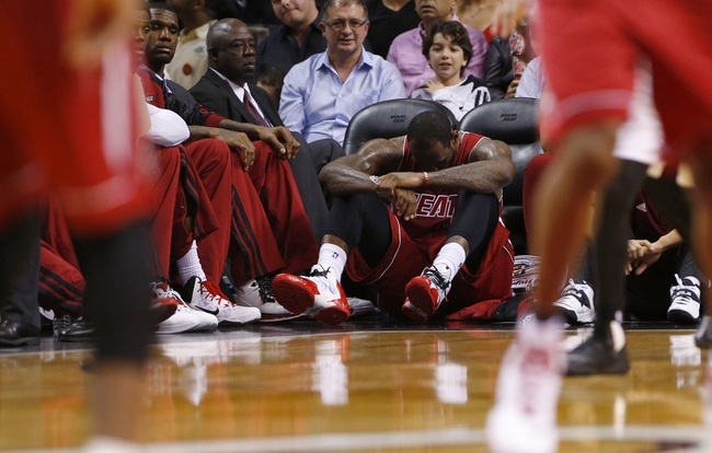 Dec 16, 2013; Miami, FL, USA;  Miami Heat small forward LeBron James (6) reacts to an injury in the third period as of a game against the Utah Jazz at American Airlines Arena. Mandatory Credit: Robert Mayer-USA TODAY Sports