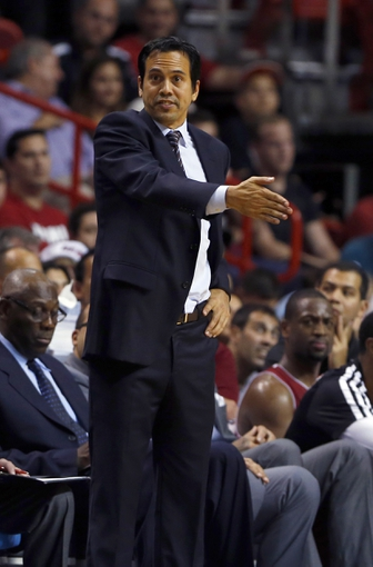 Dec 16, 2013; Miami, FL, USA;  Miami Heat head coach Erik Spoelstra in the third period of a game against the Utah Jazz at American Airlines Arena. The Heat won 117-94. Mandatory Credit: Robert Mayer-USA TODAY Sports